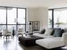 White model Flexform Soft Dream Sofa in living room with table and chairs