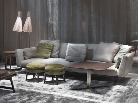 Flexform Evergreen Sofa with coloured cushions, pouf and coffee table.
